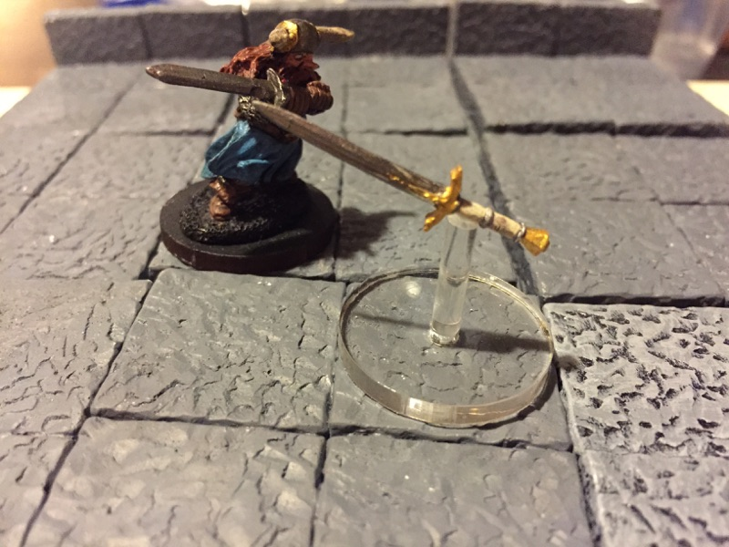 My new flying sword mini fending off a dwarven fighter.